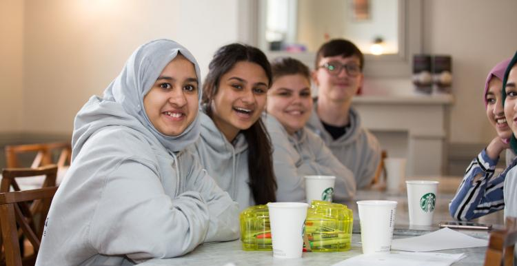 Group of young volunteers smiling at the camera