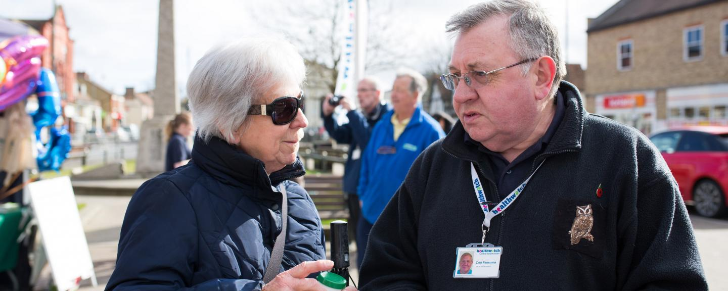 Healthwatch volunteer speaking to a member of the public outside
