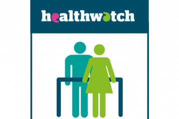 Two figures standing under Healthwatch banner