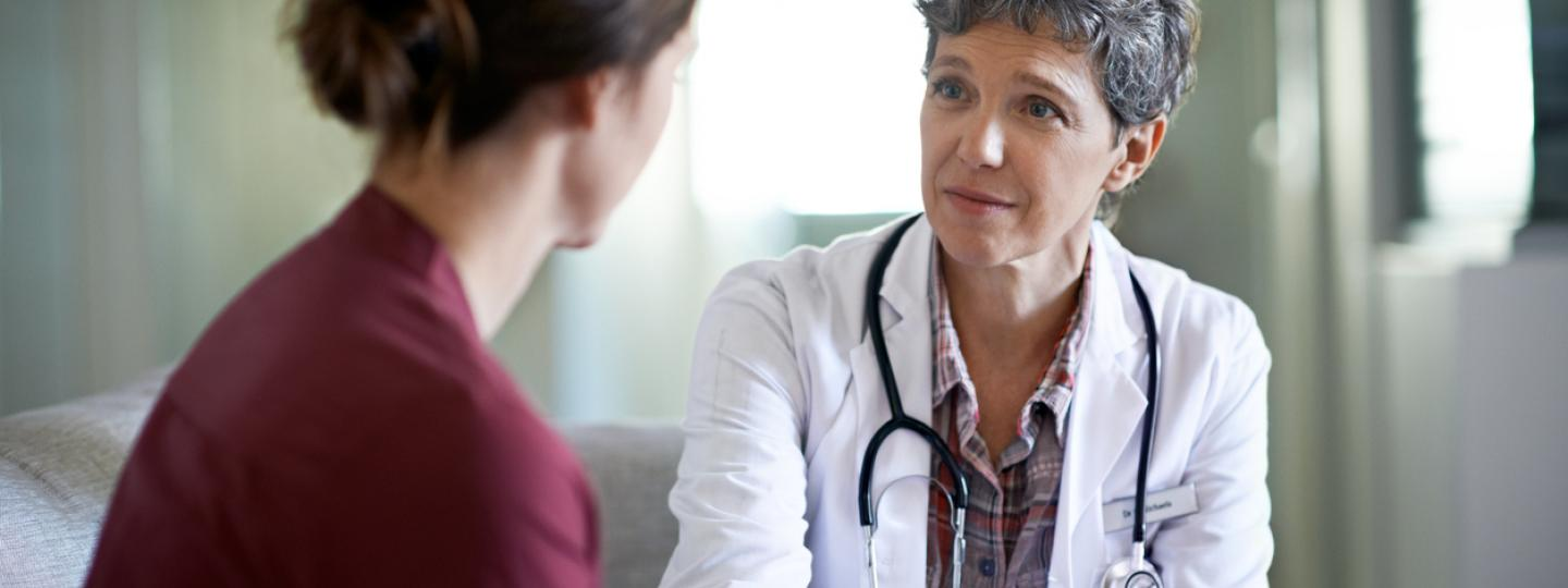 Woman talking to a GP