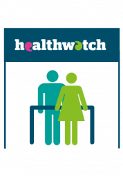 Two figures standing under Healthwatch banner